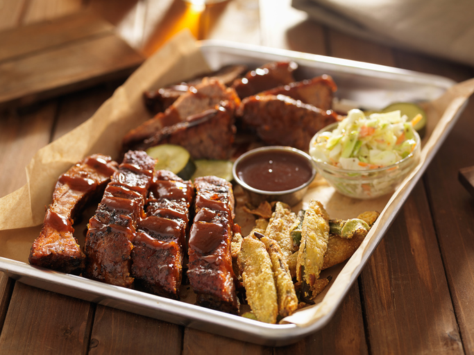 barbecue ribs with brisket, fried okrra and cole slaw on tray